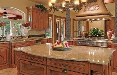 Tile with oak cabinets, venetian gold granite countertops