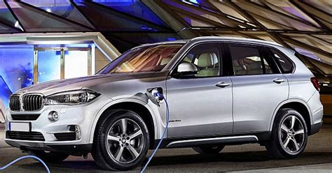 new green bmw x5 xdrive40e can be recharged at home and