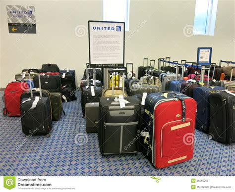 baggage united baggage laid out at airline luggage counter after flight delayed many flights been