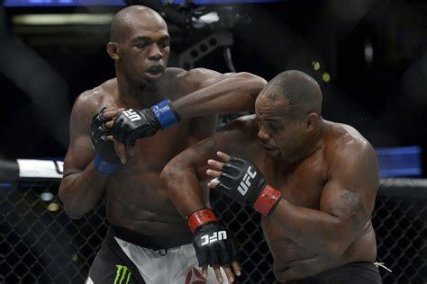 daniel cormier jon jones ufc 214 bonuses jon jones head kick knockout leads cash