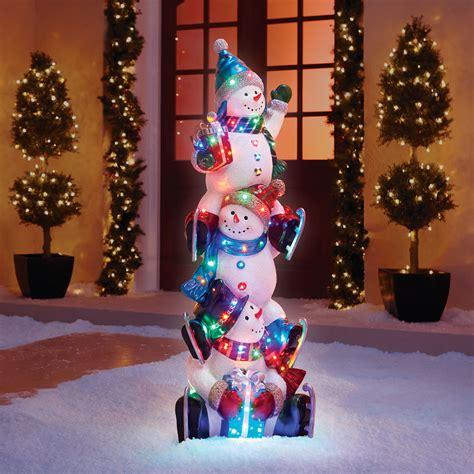 the 5 illuminated snowman totem pole hammacher schlemmer