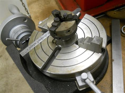 rotary table with mini lathe chuck and adjustable jaws in