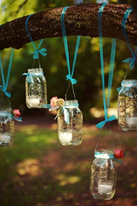 mason jars hanging from blue ribbons wedding decor