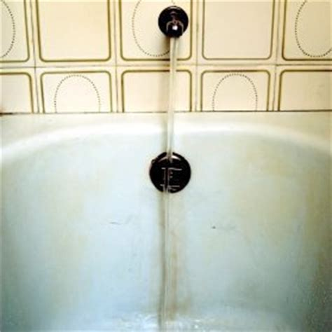how to remove rust from bathroom light fixture cleaning rust stains from a plastic bathtub thriftyfun
