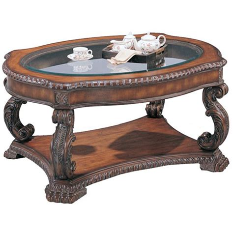 traditional oval cocktail table with glass inlay top