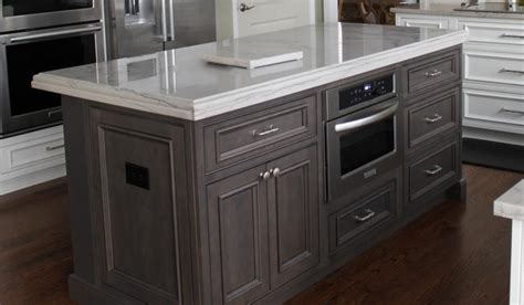 white stained maple cabinets shiloh polar white on perimeter and silas with black stain