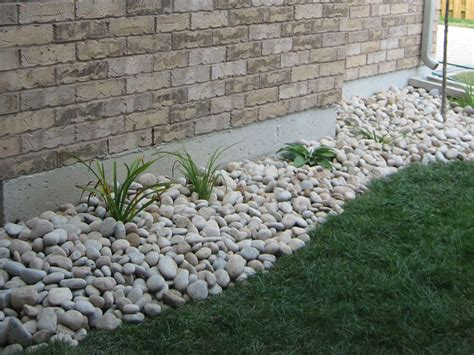 landscaping with river rock installation front yard