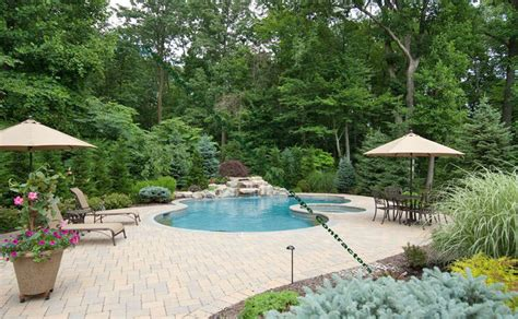 swimming pool construction with paver patio in warren nj