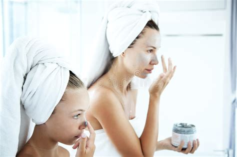 bathroom facials mother and daughter making facial mask stock image image