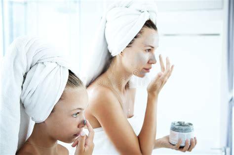 bathroom facials mother and daughter making facial mask stock image image
