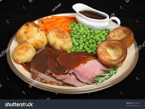 individual gravy boat roast beef dinner yorkshire pudding individual stock photo