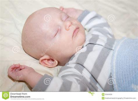 Next Baby - happily sleeping baby stock photo image 35424220