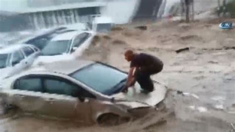 turkey floods cars swept downstream  heavy rainfall
