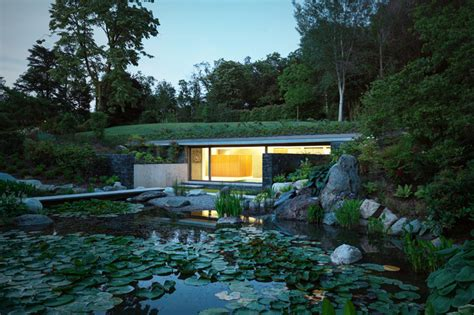 Sustainable House By The Pond Oasis Green Roofed Indoor Pool Leads To Sunken