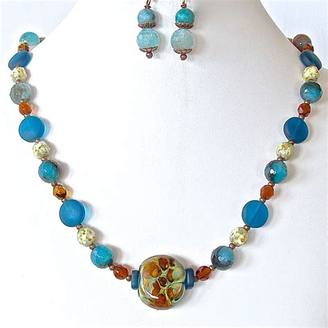 teal blue glass l cordon bleu teal necklace set earth and moon design