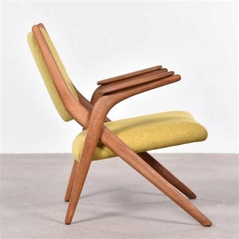 zetel jaren 60 elegante houten stoel met gekruist frame deens jaren 60