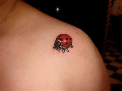 ladybug tattoo behind ear realistic green leaf and ladybug tattoo on leg
