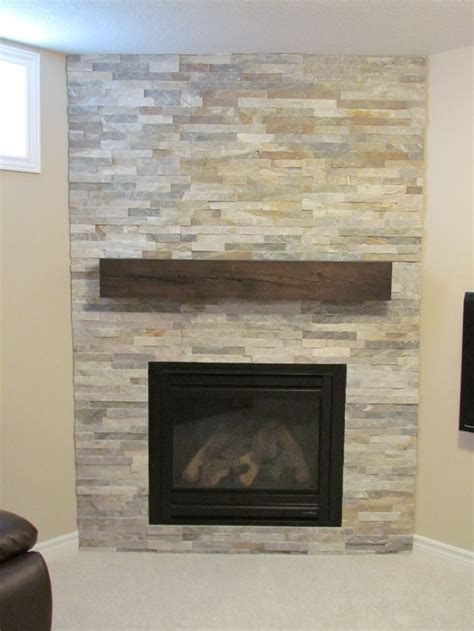 ledge fireplace with rustic reclaimed wood mantel