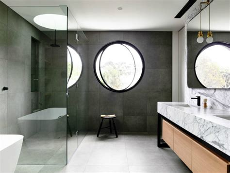 round bathroom window concrete house in australia opens up to its own yard