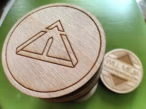 wooden nickel business cards laser engraved wooden nickel by will mejia dribbble