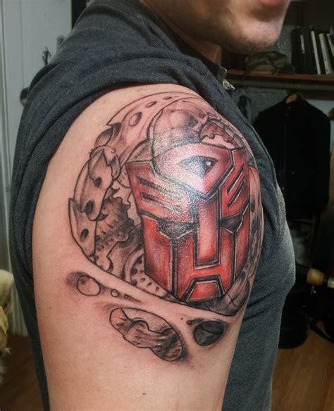 logo tattoo man transformers autobot logo tattoo www imgkid com the