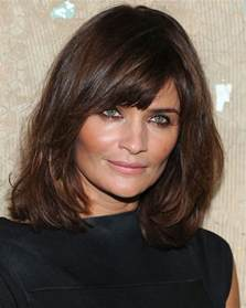 medium layered hairstyles for 50 something about shoulder length hairstyles with bangs