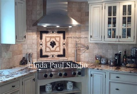 kitchen with white cabinets backsplash and bronze accents grapes mosaic tile medallion kitchen backsplash mural mosaics