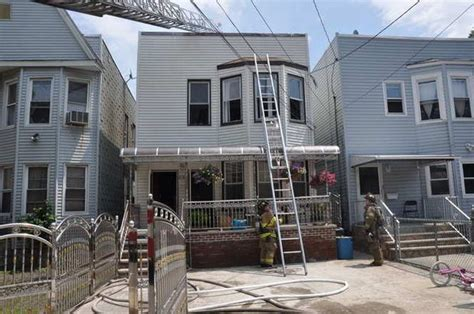 firefighters at of two alarm in residential