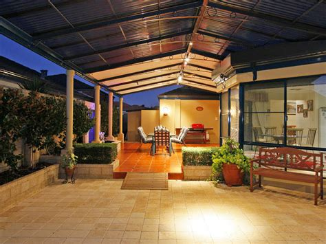 outdoor area multi level outdoor living design with bbq area hedging