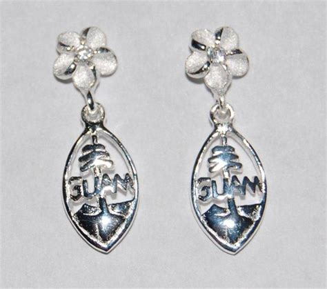 silver rhodium plated dangling guam seal earrings with