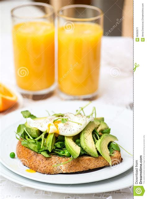 Orange Avocado Green Detox Juice by Breakfast With Wholemeal Bread Toast And Cloud Egg Royalty