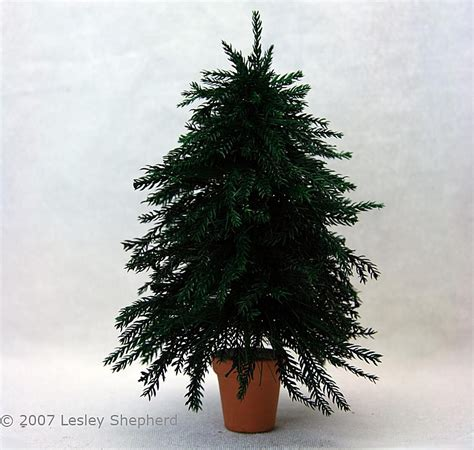 how to make a christmas tree wtih rubber gloves make a dollhouse trees from lycopodium moss