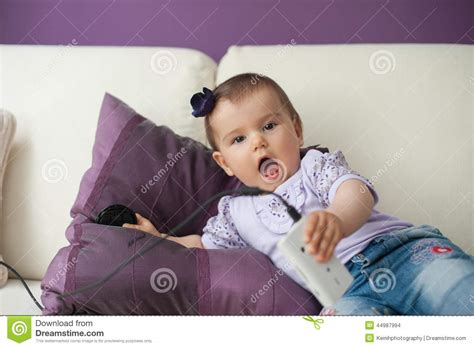 baby on couch casual baby sitting on a couch at home playing and