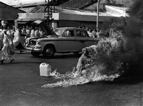 monk in the marketplace going to lead large books malcolm browne burning monk photographer dead at 81