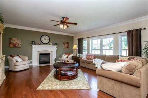 family room with fireplace and painted accent wall blue green paint colors for living room