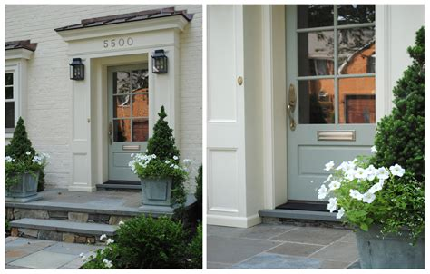 Narrow single french doors exterior with gray wooden frame and metal handle with mounted lamp