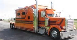 big orange semi truck sleepers