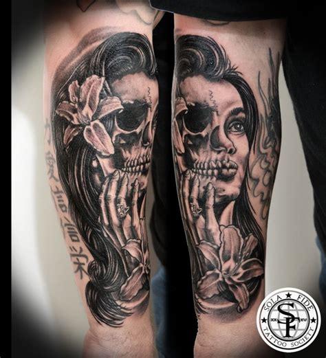 skull tattoos for women typical black ink forearm of half skull half