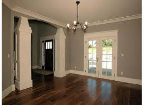 the white trim gray walls and dark wood floors love the dark door also for the front entrance