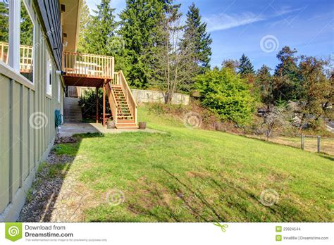 Backyard Building Plans large backyard with deck and house on the hill stock
