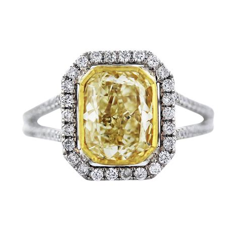 cushion cut fancy yellow engagement ring in 18k