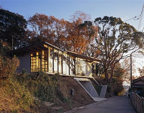 hillside houses japanese residence with wood and glass geometry