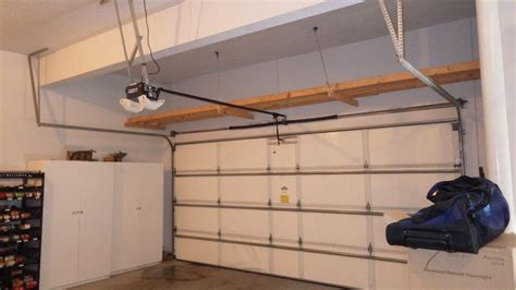 adding the garage door storage railing stairs and