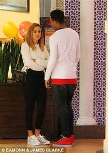 Martial and his wife engage in a conversation outside the popular