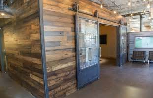 Repurposed Barn Wood Conference Room Wood Wall Covering Sliding Steel Doors