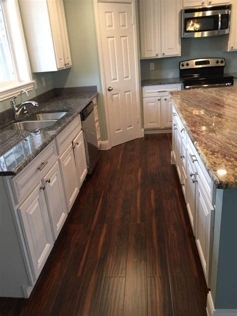 white kitchen  acacia wood floors blue ice granite