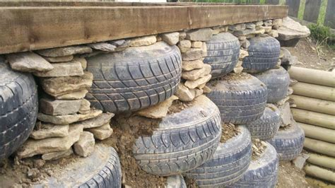 Tyre Wall As A Retaining Wall And Straw Bale Foundations Straw Bale Garden Wall