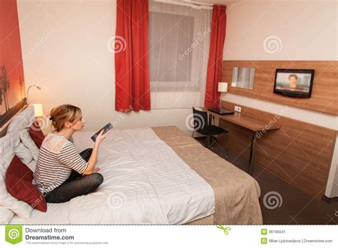 watching tv in bed girl watching tv in bed stock image image of people