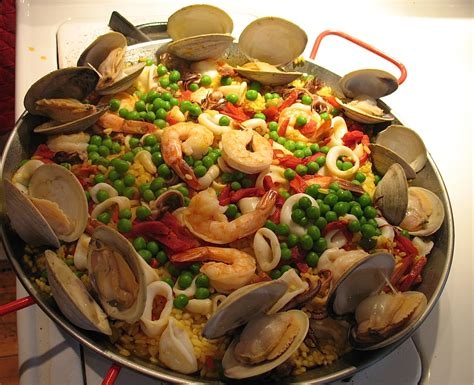 national cuisine of paella the national dish of spain lester esser