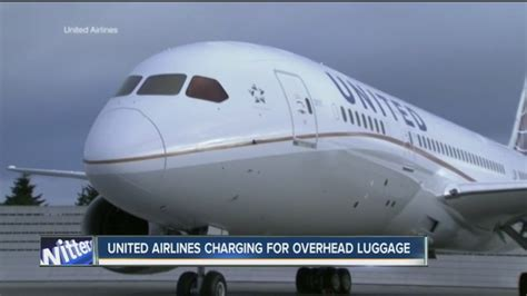 does united charge for luggage united airlines will charge extra fee for use of overhead bins wkbw com buffalo ny